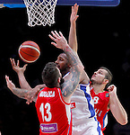 France's Boris Diaw (C) vies with Serbia's Miroslav Raduljica (L) and Nemanja Bjelica (R) during European championship basketball match for third place between France and Serbia on September 20, 2015 in Lille, France  (credit image & photo: Pedja Milosavljevic / STARSPORT)