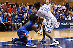 24 March 2014: DePaul's Chanise Jenkins (13) strips the ball away from Duke's Ka'lia Johnson (14). The Duke University Blue Devils played the DePaul University Blue Demons in an NCAA Division I Women's Basketball Tournament Second Round game at Cameron Indoor Stadium in Durham, North Carolina. DePaul won the game 74-65.