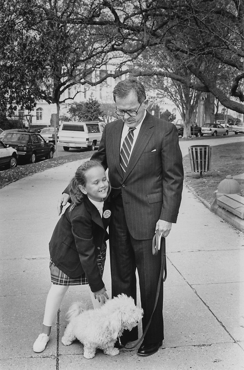 Sen. Ted Stevens, R-Alaska, with daughter Lily (age 8) and their dog Chena (Bichon Frise) on the east front of Capitol Hill on April 5, 1990. (Photo by Laura Patterson/CQ Roll Call via Getty Images)