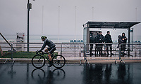 Simon Yates (GBR/Michelton-Scott) on his way to the race start on the Promenade des Anglais in torrential rained down Nice (and next to the Mediterranean Sea); where heavy armed policemen apparently take the bus to get around...<br /> <br /> 76th Paris-Nice 2018<br /> Stage 8: Nice > Nice (110km)