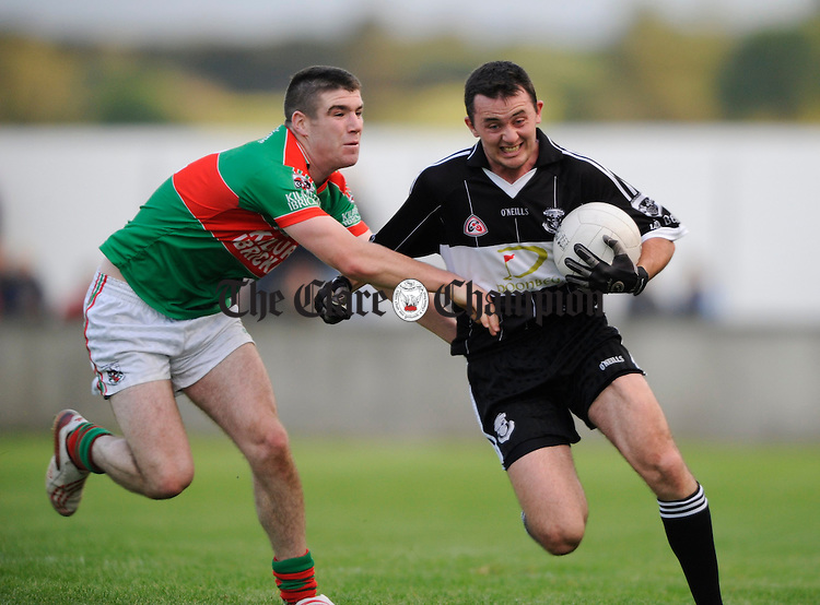 Darren Hickey of Kilmurry Ibrickane moves in on Doonbeg's David Tubridy during their Senior football semi final at Cooraclare. Photograph by John Kelly.