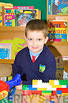 Eoin Brosnan playing with toys on his first day at school in Scoil Ide Curranes on Tuesday