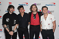 PHILADELPHIA, PA - DECEMBER 05: Michael Clifford, Calum Hood, Luke Hemmings, and Ashton Irwin of 5 Seconds of Summer attend Q102's Jingle Ball 2018 at Wells Fargo Center on December 5, 2018 in Philadelphia, Pennsylvania. Photo: imageSPACE/MediaPunch