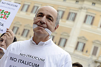 Roma, 27 Aprile 2015<br /> Manifestazione con flash mob di Ialia Unica contro la legge elettorale in discussione alla Camera dei Deputati.<br /> No Italicum, legge cerotto.<br /> Manifestanti indossano un bavaglio.<br /> Corrado Passera