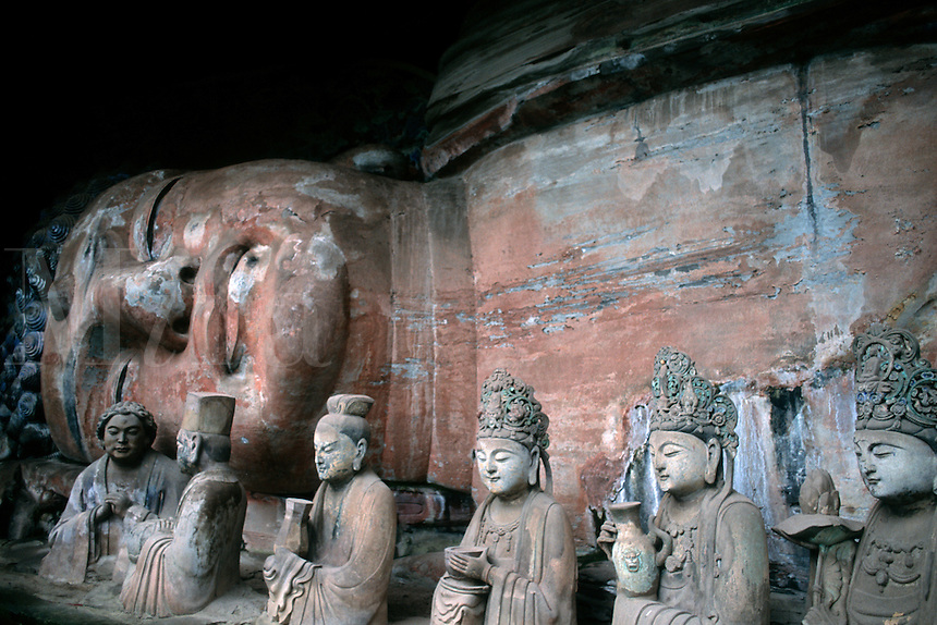 Stone carvings of Baobing Buddha Pilgrims at Dazu in China.