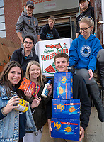 About 1,000 students and teachers of Great Lakes Secondary School passed  along 4,100 donated food items  for the Annual human Chain of Caring. Students lined the streets from the back campus to the Inn of the Good Shepherd.