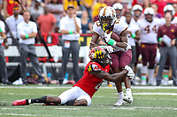 College Park, MD - September 22, 2018:  Minnesota Golden Gophers wide receiver Rashod Bateman (13) is tackled by Maryland Terrapins defensive back RaVon Davis (2) during the game between Minnesota and Maryland at  Capital One Field at Maryland Stadium in College Park, MD.  (Photo by Elliott Brown/Media Images International)