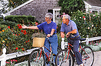 Senior couple enjoying a rose garden on a bike ride.