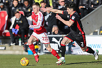 Ashley Hunter of Fleetwood Town looks to get passed George Williams of MK Dons during the Sky Bet League 1 match between Fleetwood Town and MK Dons at Highbury Stadium, Fleetwood, England on 24 February 2018. Photo by David Horn / PRiME Media Images