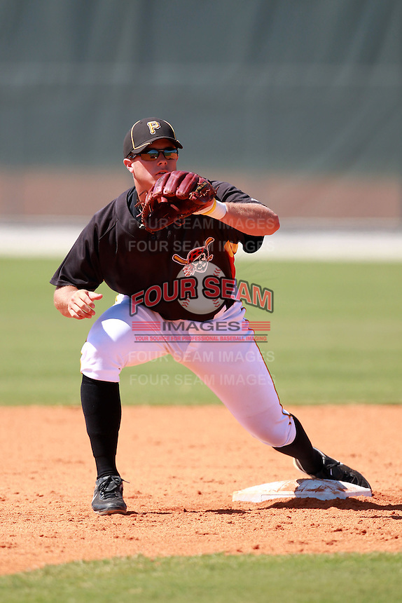 Pittsburgh Pirates minor league second baseman Walker Gourley (18) vs. the Philadelphia Phillies in an Instructional League game at Pirate City in Bradenton, Florida;  October 6, 2010.  Photo By Mike Janes/Four Seam Images