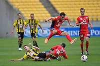Tyler Boyd and Bruce Djite during the A League - Wellington Phoenix v Adelaide United, Wellington, New Zealand on Sunday 30 March 2014. <br /> Photo by Masanori Udagawa. <br /> www.photowellington.photoshelter.com.