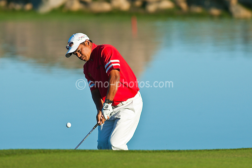 Feb 25, 2009; Marana, AZ, USA; Prayad Marksaeng (THA) chips on to the 3rd hole during a match against Lee Westwood (ENG-not pictured) during the first round of the World Golf Championships-Accenture Match Play Championship at the Ritz-Carlton Golf Club, Dove Mountain.