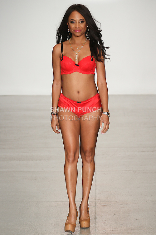 Model walks runway in lingerie from the Affinitas & Parfait collection for the PinkChoseMe runway showcase as part of the Fashion Week SS15 Official Closing Show, during LingerieFW Spring Summer 2015.