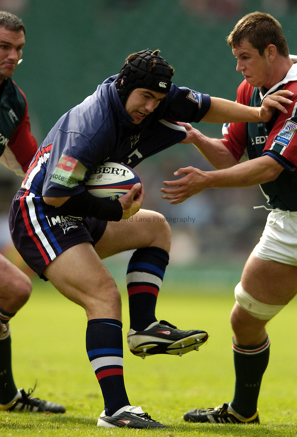 Photo: Richard Lane..Leicester Tigers v Sale Sharks. Zurich Wildcard Final at Twickenham. 29/05/2004..Phil Davies is tackled by the Leicester locks.