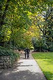 USA, Oregon, Ashland, a young man and woman walk through Lithia Park in the Fall