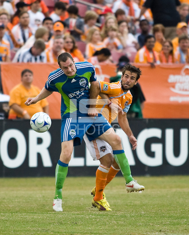 Seattle Sounders midfielder Nate Jaqua (21) and Houston Dynamo defender Mike Chabala (17) fight for control of the ball.  Houston Dynamo defeated Seattle Sounders FC with an aggregate score of 1-0 in the second leg of the Western Conference semifinals at Robertson Stadium in Houston, TX on November 8, 2009.