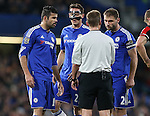 Referee Michael Jones has words with Chelsea's Branislav Ivanovic after Diego Costa's booking<br /> <br /> Barclays Premier League - Chelsea v AFC Bournemouth - Stamford Bridge - England - 5th December 2015 - Picture David Klein/Sportimage
