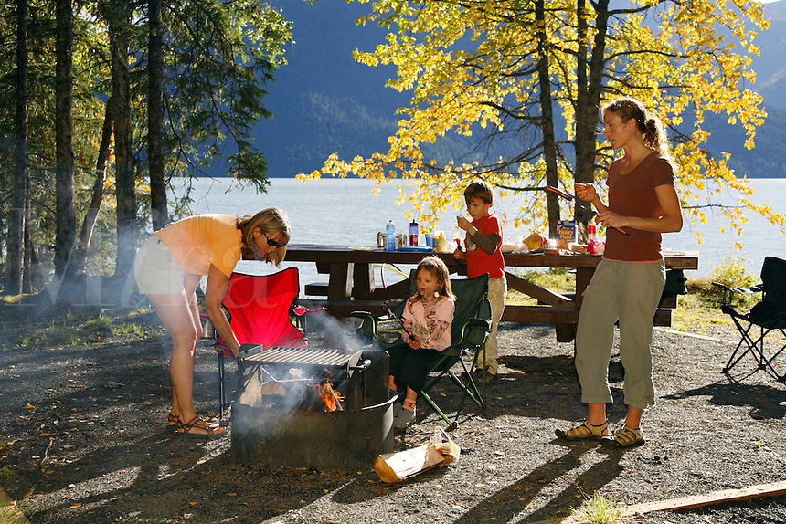 Roasting marshmallows during family picnic at Trail Lake Campground, Kenai Peninsula, Chugach National Forest, Alaska.