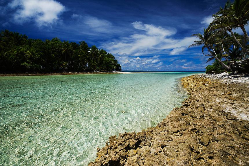 A chanel runs between ocean and lagoon at Eneko Island, Majuro Atoll, Marshall Islands