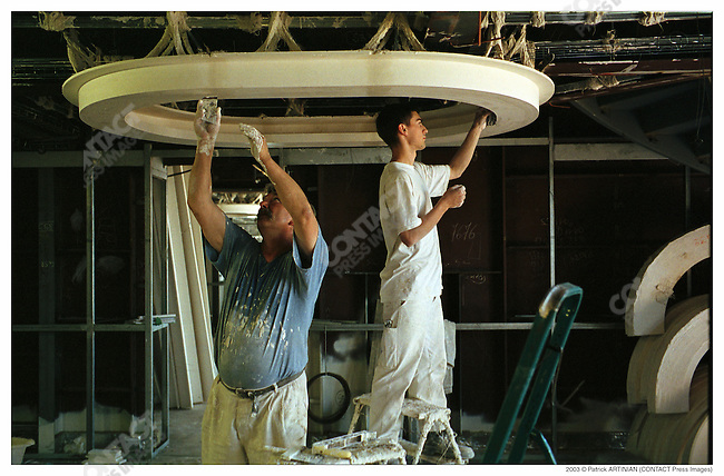 Construction of Queen Mary 2, Alstom Marine, Chantiers de l'Atlantique, Saint-Nazaire, France, June, 2003. Installing the fittings of one of the luxury cabins (duplex) at the back of the ship.