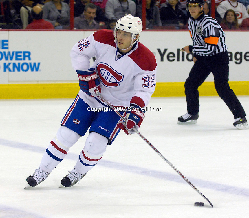 Montreal Canadiens' Mark Streit carries the puck against the Carolina Hurricanes during their game Friday, Oct. 26, 2007 in Raleigh, NC. The Canadiens won 7-4.