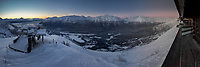 A panoramic view of Turnagain Arm and the Chugach Mountains from Alaska's Alyeska Resort displays a wonderful suunset transitioning into alpenglow.