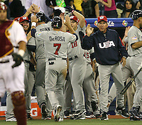 March 8, 2009:  Mark DeRosa (7) of Team USA is greeted by teammates and Davey Johnson after scoring a run during the first round of the World Baseball Classic at the Rogers Centre in Toronto, Ontario, Canada.  Team USA defeated Venezuela  15-6 to secure a spot in the second round of the tournament.  Photo by:  Mike Janes/Four Seam Images