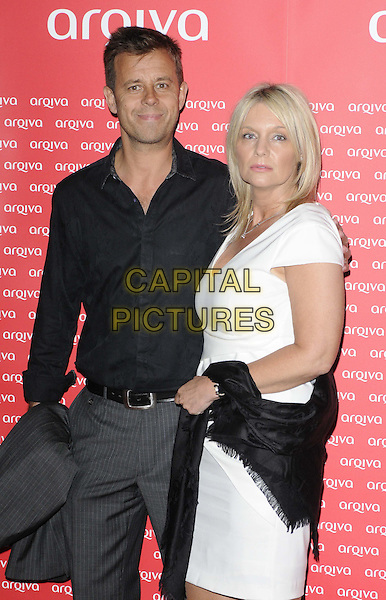 Pat Sharp & guest.The Arqiva Commercial Radio Awards, Park Plaza Westminster Bridge Hotel, Westminster Bridge, London, England..July 4th, 2012.half length black shirt white dress .CAP/CAN.©Can Nguyen/Capital Pictures.