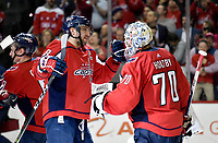 WASHINGTON, DC - APRIL 04: Washington Capitals left wing Alex Ovechkin (8) congratulates goalie Braden Holtby (70) after the game upon winning the Metropolitan Division during the Montreal Canadiens vs. Washington Capitals NHL hockey game April 4, 2019 at Capital One Arena in Washington, D.C.. (Photo by Randy Litzinger/Icon Sportswire)