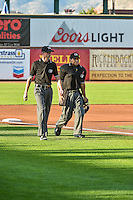 Umpires Luis Hernandez and Isaias Barba walk onto the field of the Ogden Raptors before the game against the Orem Owlz in Pioneer League action at Lindquist Field on August 28, 2015 in Ogden, Utah. Ogden defeated Orem 14-6.  (Stephen Smith/Four Seam Images)
