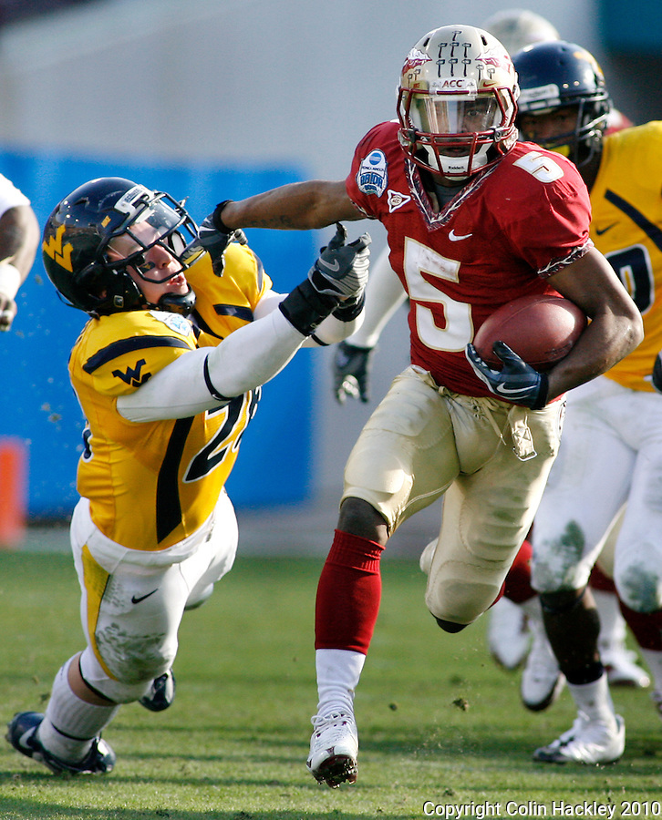 JACKSONVILLE, FL 1/1/10-FSU-WV FB CH41-Florida State's Greg Reid leaves West Virginia's Jordan Roberts in the dust during his 69 yard kick off return during second half Gator Bowl action Friday in Jacksonville, Fla. The Seminoles beat the Mountaineers 33-21..COLIN HACKLEY PHOTO