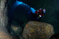 RS0292-D. scuba diver (model released) swimming through one of the many tunnels in Cathedral Cave, the largest sea cave system in Australia. Waterfall Bay, Tasman Peninsula. Tasmania, Australia, Pacific Ocean.<br /> Photo Copyright &copy; Brandon Cole. All rights reserved worldwide.  www.brandoncole.com