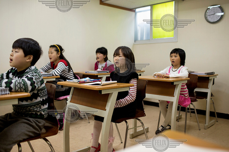 Children in a classroom during a lesson at Kumgang School. It caters to children whose parents have defected from North Korea. /Felix Features