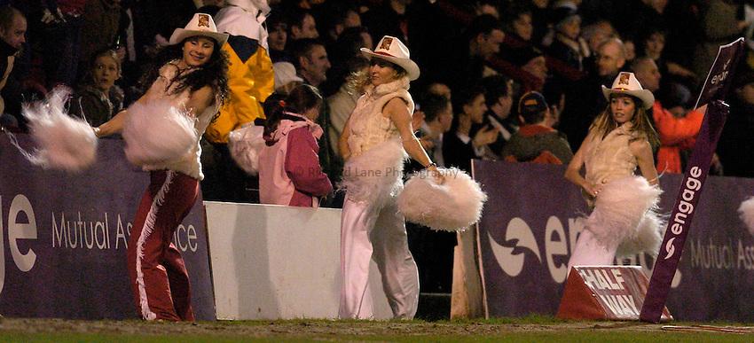 Photo: Alan Crowhurst..London Broncos v Wigan Warriors. Engage Super League. 12/03/2005..Broncos cowgirls celebrate.