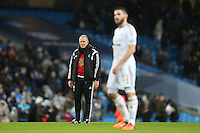 Swansea City Manager Alan Curtis looks on at the end of the Barclays Premier League Match between Manchester City and Swansea City played at the Etihad Stadium, Manchester on 12th December 2015