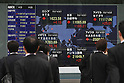 Apr 21, 2010 - Tokyo, Japan - Pedestrians walk past an electronic stock board outside a securities firm in Tokyo, Japan, on April 21, 2010. The 225-issue Nikkei Stock Average gained 168.09 points, or 1.54 percent, from Tuesday at 11,068.77.