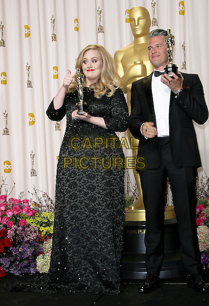 Adele (Adele Laurie Blue Adkins) & Paul Epworth.85th Annual Academy Awards held at the Dolby Theatre at Hollywood & Highland Center, Hollywood, California, USA..February 24th, 2013.pressroom oscars full length trophies  beads beaded winners black dress tuxedo white shirt glasses award trophy winner funny smiling hand thumb up.CAP/ADM.©AdMedia/Capital Pictures.