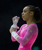 22nd March 2018, Arena Birmingham, Birmingham, England; Gymnastics World Cup, day two, womens competition; Margzetta Frazier (USA) preparing her hand protectors before warming up on the Uneven Bars before the competition