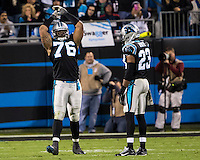 The Carolina Panthers play the New England Patriots at Bank of America Stadium in Charlotte North Carolina on Monday Night Football.  The Panthers defeated the Patriots 24-20.  Carolina Panthers defensive end Greg Hardy (76), Carolina Panthers cornerback Melvin White (23)