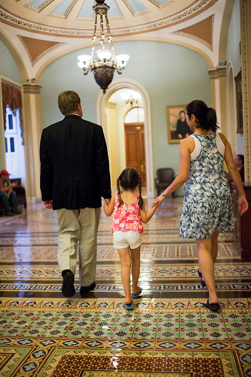 UNITED STATES - JULY 31:  Sen. Jim Webb, D-Va., walks with his wife Hong Le and daughter Georgia, 4, in the Ohio Clock Corridor after  Senate leaders announced a deal had been reached on raising the debt ceiling. (Photo By Tom Williams/Roll Call)