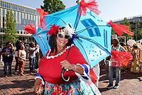 Nederland Amsterdam -  juli 2018.    Amsterdam viert 50 jaar Bijlmer. De SouthEast Parade. Deze parade wordt georganiseerd om de diversiteit van Amsterdam Zuidoost te laten zien. Vrouw met roots in de Dominicaanse Republiek.   Foto mag niet in negatieve context gepubliceerd worden.     Foto Berlinda van Dam /  Hollandse Hoogte
