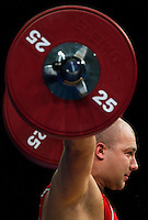 11 DEC 2011 - LONDON, GBR - Bartlomiej Bonk (POL) lifts  during the men's +105kg category Snatch at the London International Weightlifting Invitational and 2012 Olympic Games test event held at the ExCel Exhibition Centre in London, Great Britain .(PHOTO (C) NIGEL FARROW)