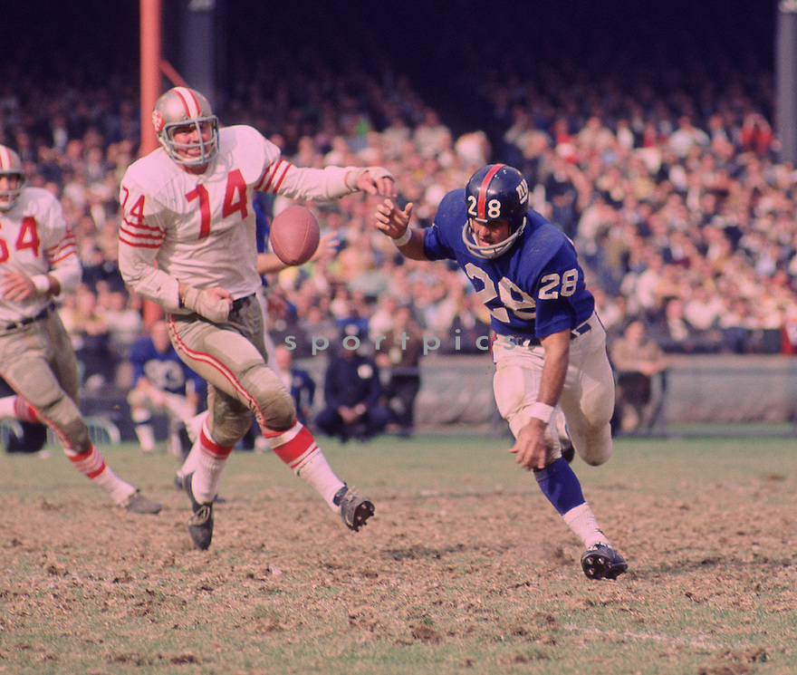 San Francisco 49ers Clark Miller (74) during a game against the New York Giants on October 20, 1968 at Yankee Stadium in the Bronx, New York.  The  San Francisco 49ers beat the New York Giants 26-10. Clark Miller played for 9 season with 3 different teams.San Francisco 49ers Clark Miller (74) runs down New York Giants Bobby Duhon (28) during a game against the New York Giants on October 20, 1968 at Yankee Stadium in the Bronx, New York.  The  San Francisco 49ers beat the New York Giants 26-10. Clark Miller played for 9 season with 3 different teams.(SportPics)