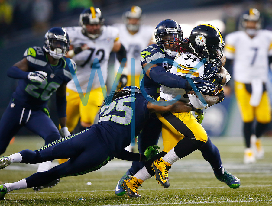 DeAngelo Williams #34 of the Pittsburgh Steelers is tackled by Bobby Wagner #54 and Richard Sherman #25 of the Seattle Seahawks in the second half during the game at CenturyLink Field on November 29, 2015 in Seattle, Washington. (Photo by Jared Wickerham/DKPittsburghSports)