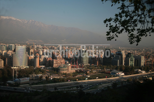 View of Las Condes and Northern Santiago, with the Andes mountain range in the background.