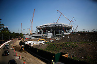 General view of the Arthur Ashe Stadium while workers install the last final piece of steel for the roof structure in the Arthur Ashe Stadium at the USTA Billie Jean King National Tennis Center in New York.  06/10/2015. Eduardo MunozAlvarez/VIEWpress