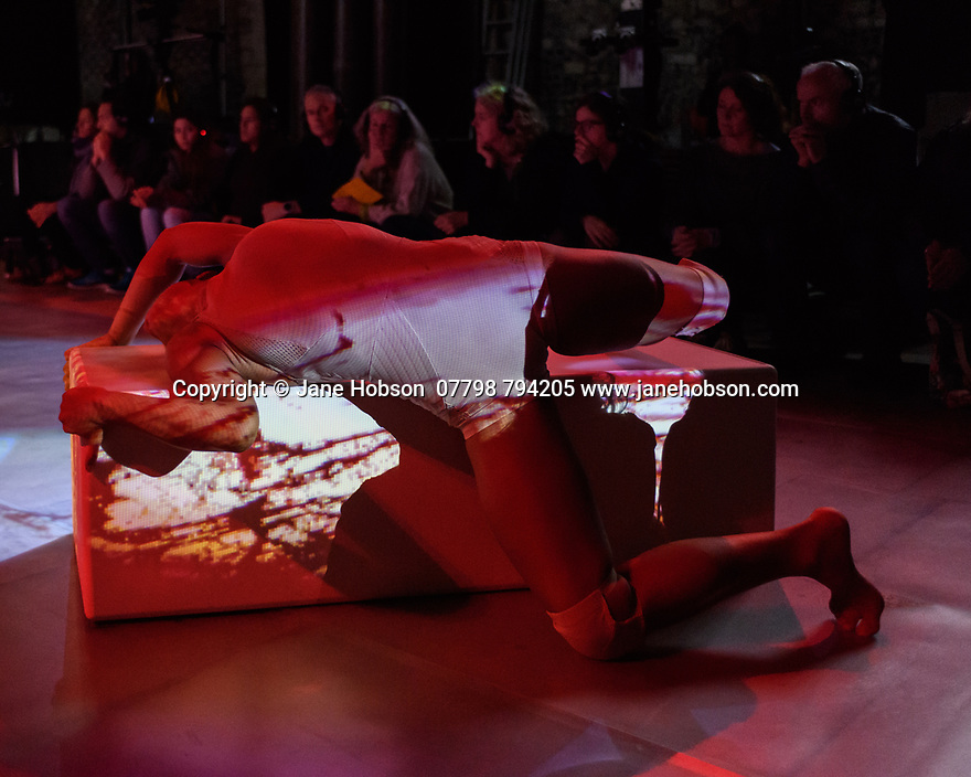 "Winchester, Hants, UK. 22.09.2018. Shobana Jeyasingh Dance perform ""Contagion"", in the Great Hall, Winchester. ""Contagion"" is directed and choreographed by Shobana Jeyasingh, with projection design by Nina Dunn, lighting design by Yaron Abulafia, and set and costume design by Merle Hensel. Contagion is co-commissioned by 14-18 NOW, the UK's arts programme for the First World War centenary.<br />