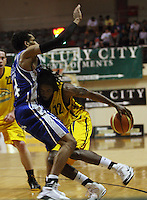 Saints import Phillip Gilbert fouls Mike Efevberha during the NBL Round 9 match between the Wellington Saints and Nelson Giants at TSB Bank Arena, Wellington, New Zealand on Thursday 7 May 2009. Photo: Dave Lintott / lintottphoto.co.nz