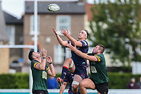 Alex Woolford of London Scottish (centre) looks to collect a high ball during the Greene King IPA Championship match between London Scottish Football Club and Nottingham Rugby at Richmond Athletic Ground, Richmond, United Kingdom on 15 April 2017. Photo by David Horn.