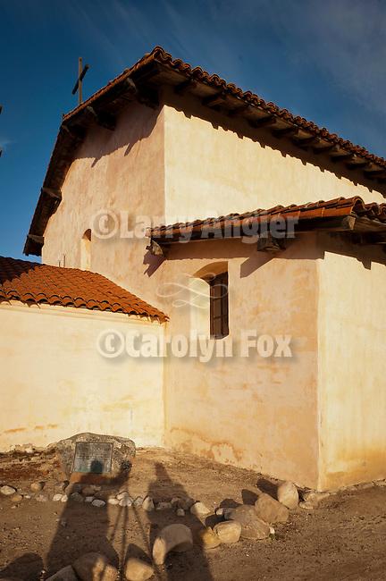 Photographer shadows, chapel walls, Mission San Antonio de Padua, California.